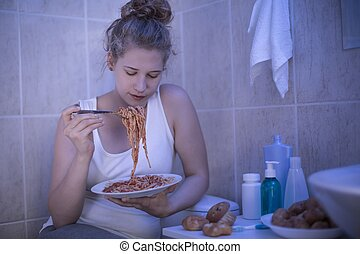 Girl eating spaghetti - Teenage girl eating spaghetti in...