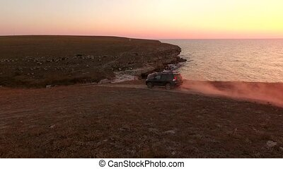 AERIAL VIEW. Offroader Car Driving Along Tarkhankut Coast At...