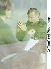 Psychologist examining depressed military man - Picture of...