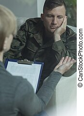 Soldier with mental problem - Picture of sad young soldier...