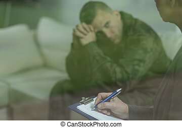 Soldier with mental health problem - Photo of young soldier...