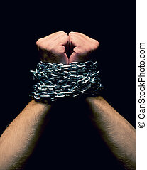 Rised up chained hands Isolated on black