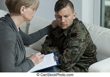 Psychiatrist helping war veteran - Picture of psychiatrist...
