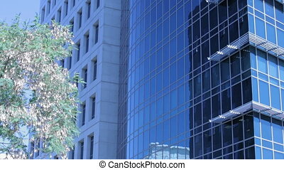 Zoom in on an office building windows Establishing shot of...