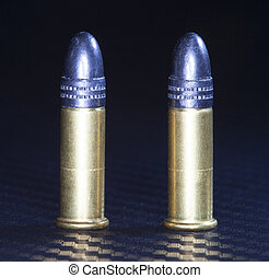Ammo - Pair of cartridges for use in rimfire twenty two...