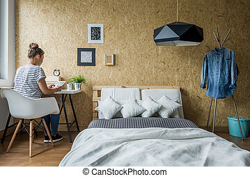 Girl in room - Young girl sitting at desk in her room