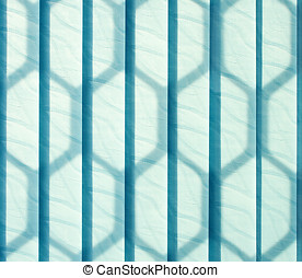 Vertical jalousie. Background - Blue vertical jalousie made...