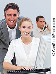 Pensive business team working at a computer