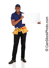 african repairman holding white board