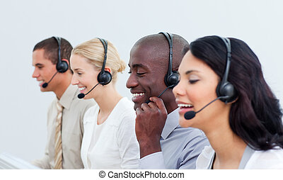 Laughing business people working in a call center