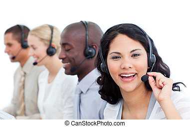 Attractive businesswoman and her team working in a call...