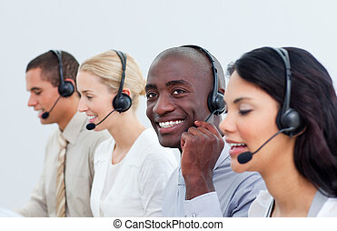 Radiant business people working in a call center