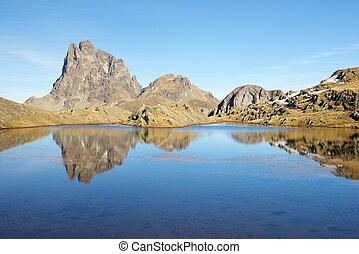 Pyrenees - Midi Dossau Peak reflected in a lake Ossau...