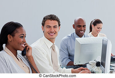 Radiant business team working at a computer in the office