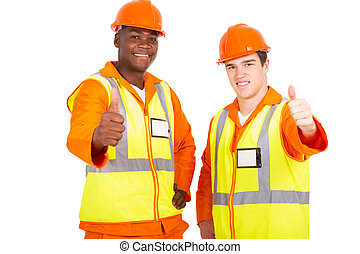young engineers giving thumbs up