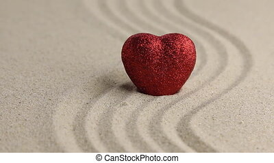 The heart standing in the undulating sand, removal
