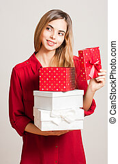 Beautiful young woman with gift boxes - Portrait of a...