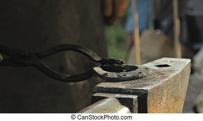 Blacksmith make a horseshoe, HD