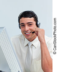 Assertive businessman talking on headset at work