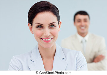 Attractive businesswoman standing in front of her colleague...