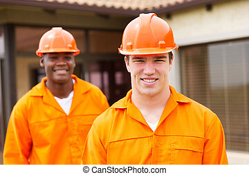 young builder and co-worker - happy young builder and...