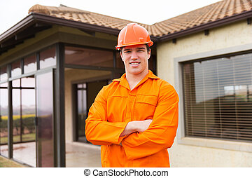 construction worker in front of a house