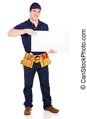 young handyman pointing at blank white board - happy young...