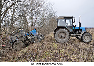 Tractor towing stuck tractor - Tractor trying to pull a...