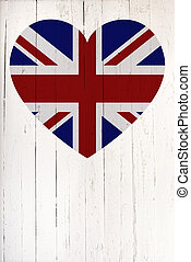British flag in heart shape on a white wooden board - a...