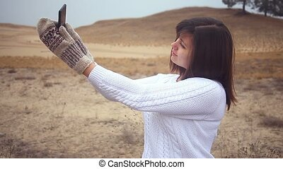 woman girl smartphone makes self phone mittens pullover...