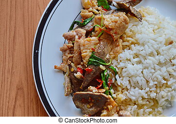 spicy stirfried slice pork and pork liver with basil