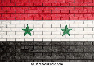 Flag of syria painted over on old brick wall