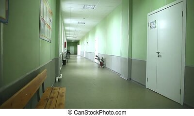 school empty corridor interior green wall to the right...