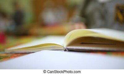 girl teen read book schoolgirl big hands sitting at desk in...