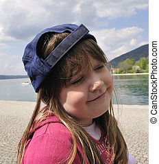 little girl with cap
