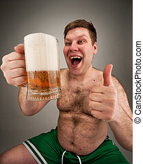 Funny fat man drinking beer - Portrait of funny fat man...