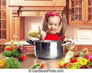 Little girl cooking - Funny little girl is cooking at home