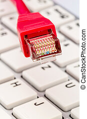 network cable on keyboard, symbol photo for flatrate,...