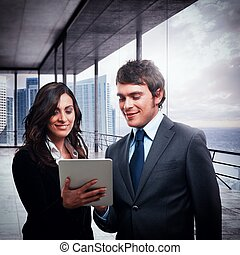 View project on tablet - Businesspeople together analyze...