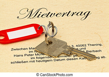 apartment keys and rental agreement - the key of an...