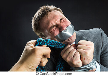 Man with mouth covered by masking tape - Man in capture with...