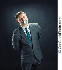 Man with mouth covered by masking tape - Standing man with...
