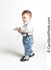 cute chinese baby - naughty cute chinese baby, holding a...