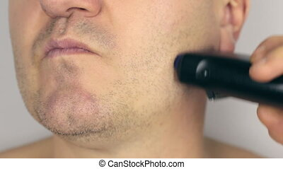 Closeup  shave a man, shave electric razor, first part