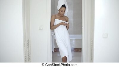 Woman Texting In Bathroom And Smiling - Happy african...