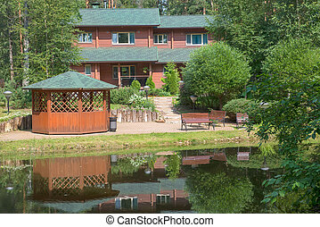 House with a gazebo near the water