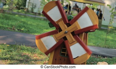 Small windmill model in the grass