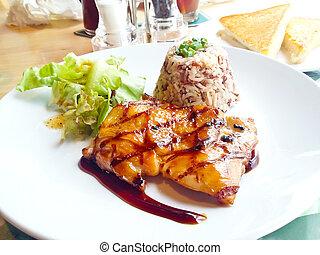 Chicken steak in a dish Serve with rice