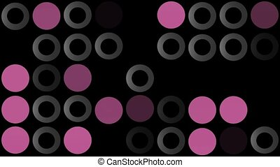 Flashing circles in grey and purple on black