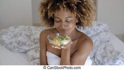 Close Up Of A Woman Enjoying A Healthy Salad - Portrait of...
